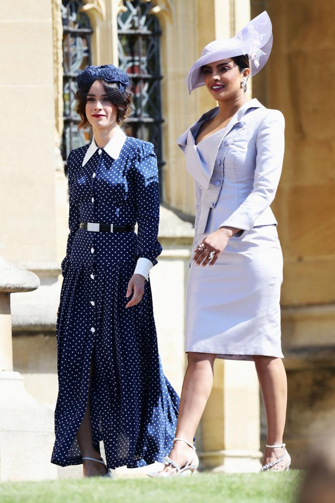 Abigail Spencer, in Alessandra Rich, and Priyanka Chopra, in Vivienne Westwood, attending the wedding of Prince Harry and Meghan Markle in 2018.
