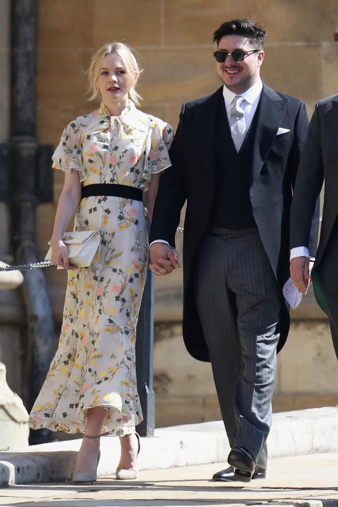 Carey Mulligan, in Erdem, (and Marcus Mumford) attending the wedding of Prince Harry and Meghan Markle in 2018.