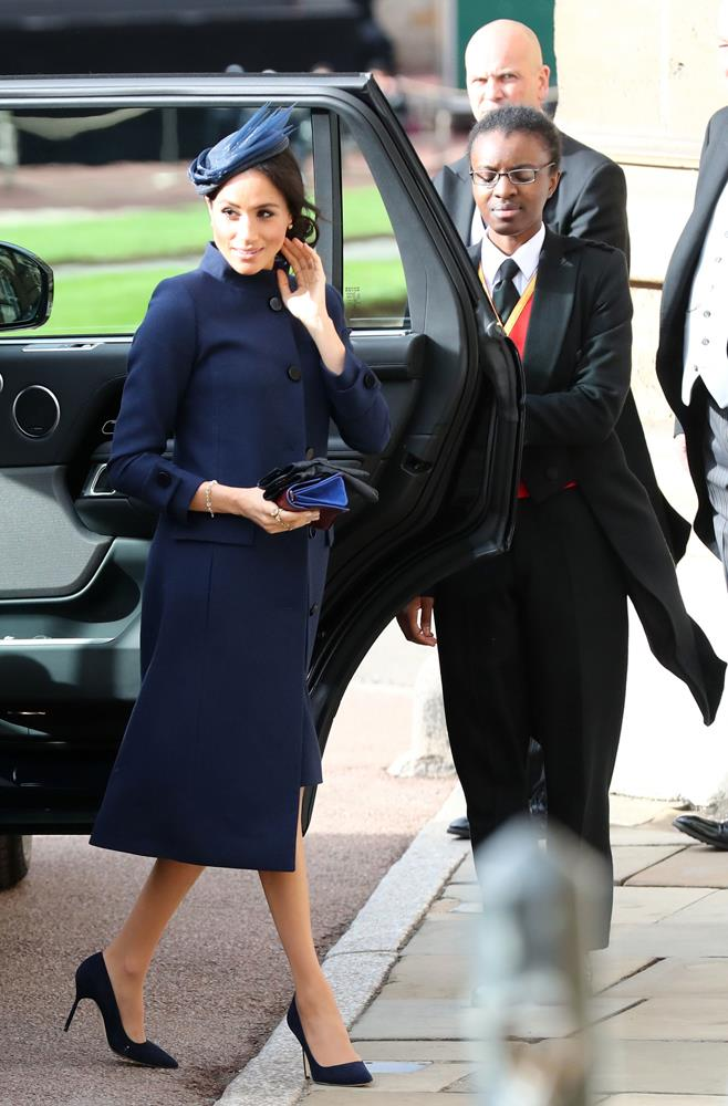 Meghan, Duchess of Sussex, in Givenchy, attending the wedding of Princess Eugenie of York and Jack Brooksbank in 2018.