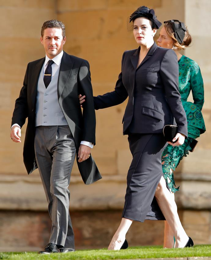 Liv Tyler, in Stella McCartney, (and Dave Gardner) attending the wedding of Princess Eugenie of York and Jack Brooksbank in 2018.