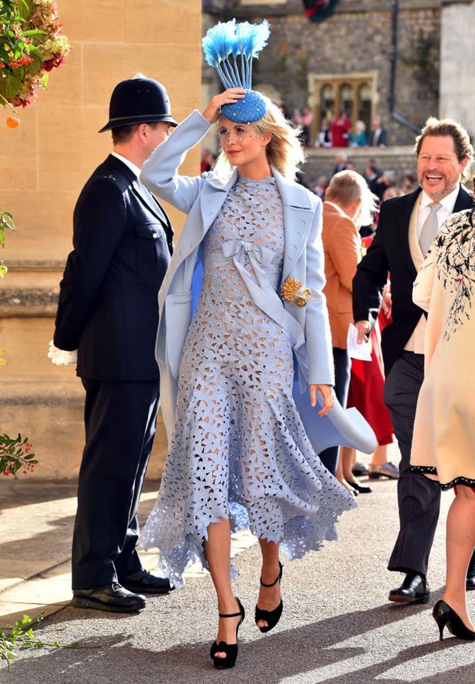 Poppy Delevingne, in Oscar de la Renta, attending the wedding of Princess Eugenie of York and Jack Brooksbank in 2018.