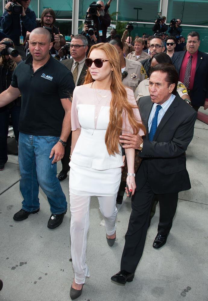 Lindsay Lohan was required at court for allegedly violating her probation and lying to a police officer after a vehicle crash. Though this wasn't her first or last court appearance, this distinct look was surely one to remember.