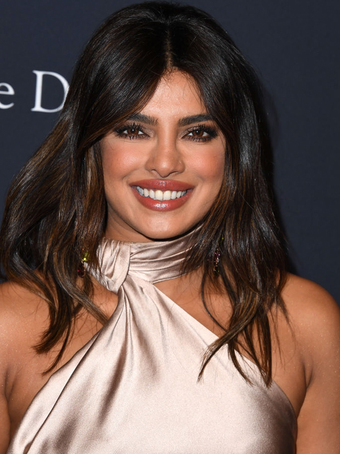 Chopra may be a fan of experimenting with bold hues and polished pulled-back hair, but caramel colours and down-dos are just as striking on her.<br></br> *Via: Getty Images*