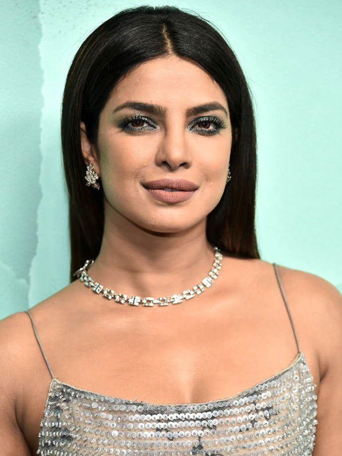 Chopra's use of Tiffany blue complements her brown eyes beautifully, with the latte lip proving the perfect understated choice.<br></br> *Via: Getty Images*