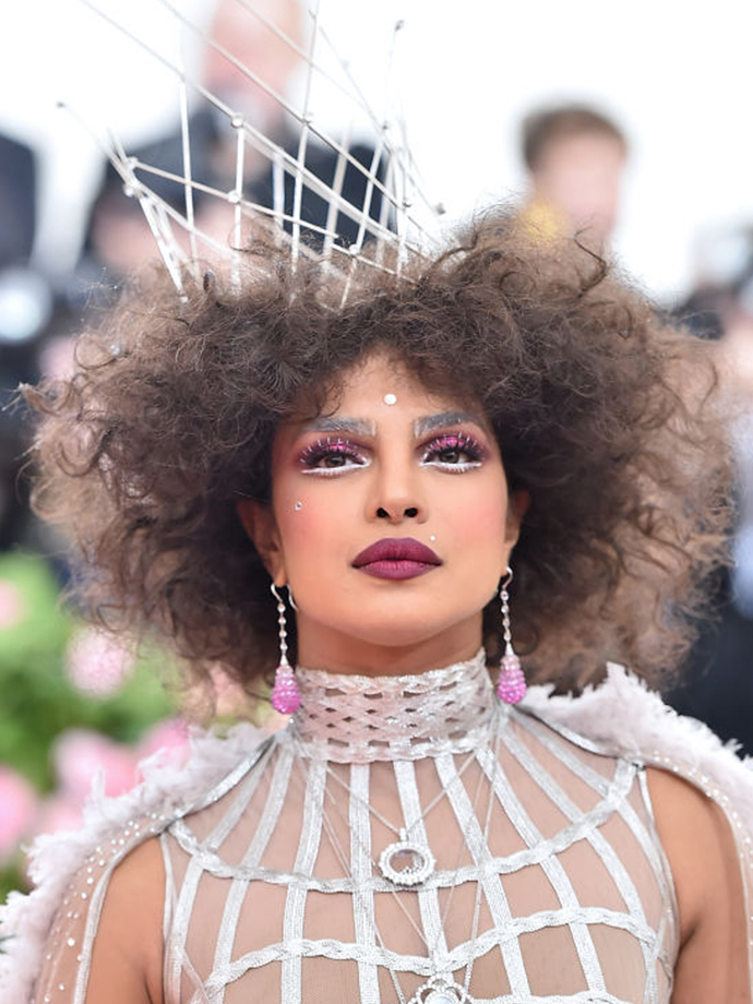 It's safe to say no feature was left behind when creating this look; the statement berry eye and lip duo could only be outshone by this curls-and-crown pairing.<br></br> *Via: Getty Images*