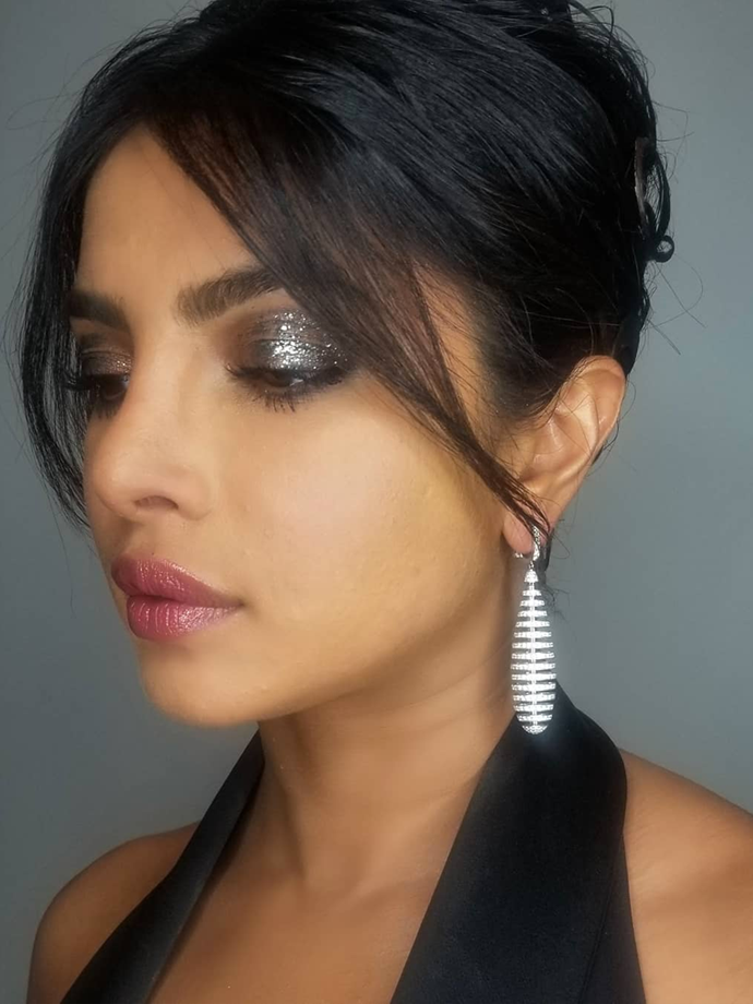 Her chic chignon and flawless skin are stunning, yes, but let's be honest: this look is *all* about the eyes. *This* is how to do sparkle in 2020.<br></br> *Via: Instagram/@patidubroff*
