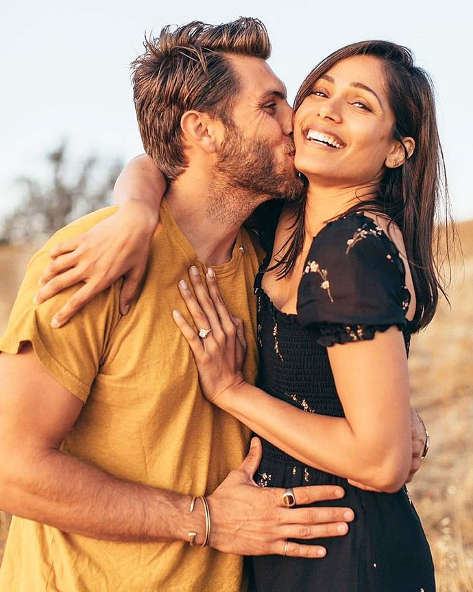***Freida Pinto***<br><br> While her husband-to-be embraced colour, Freida Pinto wore a black floral dress with puff sleeves in her engagement announcement portrait.