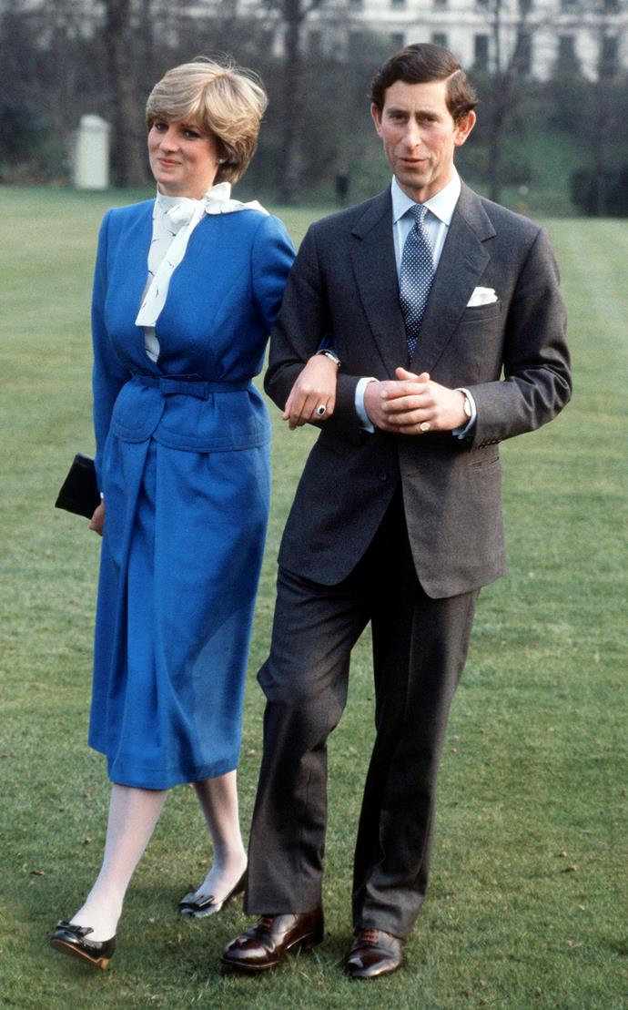***Lady Diana Spencer***<br><br> For the announcement of her engagement to Prince Charles at Buckingham Palace, Lady Diana Spencer wore a bright blue skirt-suit with a necktie. However, according to legend, the was a *Pretty Woman* moment behind the ensemble. Reports say that Diana had visited London boutique Bellville Sassoon for a dress. When the French sales assistance didn't recognise her and told her to visit a more budget-friendly store, Diana went to Harrods, where she plucked this look off the rack. Big mistake. *Huge.*