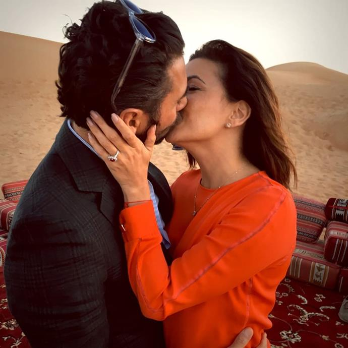 """***Eva Longoria***<br><br> Let it be known: if your boyfriend proposes in the middle of a Dubai desert, wear a chic outfit. Eva Longoria chose a red, long-sleeved dress with delicate sheer panelling (which, incidentally, matched her [ruby engagement ring](https://www.harpersbazaar.com.au/bazaar-bride/celebrities-coloured-engagement-rings-19073