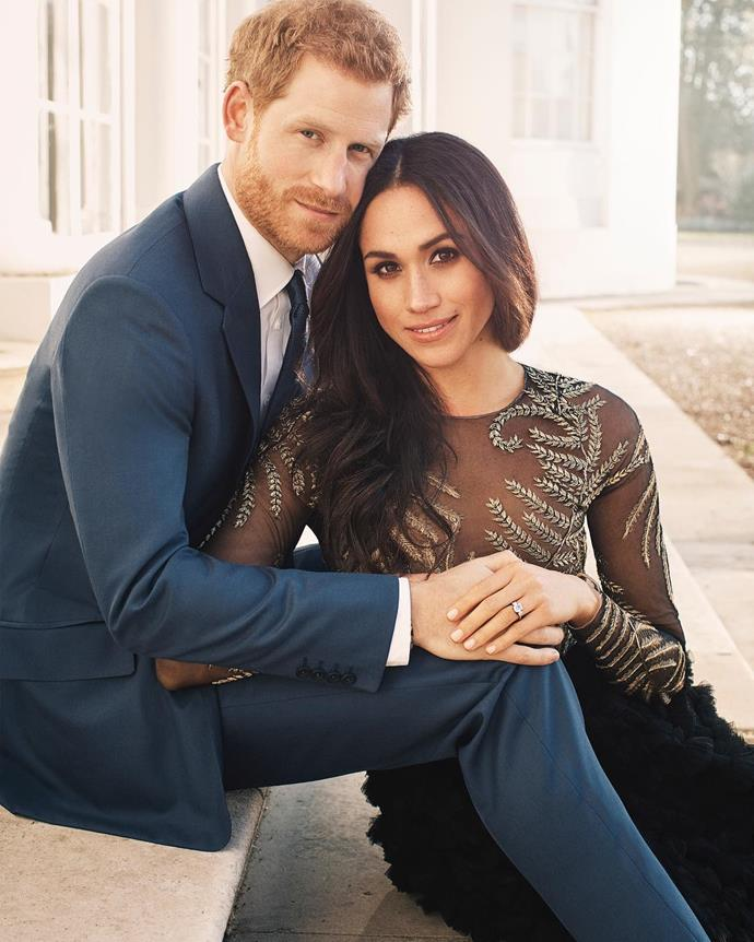 """***Meghan Markle***<br><br> Following up her in-person announcement, Meghan and Harry posed for a series of portraits to commemorate the occasion. The most iconic of all of them is this shot, where Meghan is wearing a scandalous (by royal standards) """"naked dress"""" by Australian design duo Ralph & Russo."""