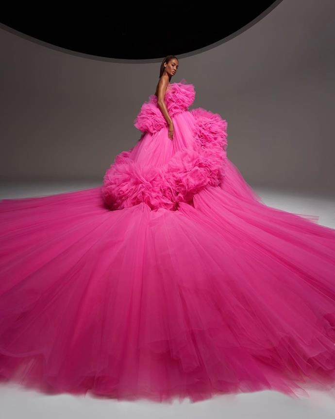 "**Giambattista Valli's Tulle And Bow-Filled Ode To Paris**<br><br>  Known for his love of billowing tulle and unapologetic use of colour, Giambattista Valli's couture collection for autumn 2020 was true to his signature style. To present the looks, the Italian designer tapped supermodel Joan Smalls to wear 18 different voluminous gowns.<br><br>  A colourful cacophony of bubble waists, tiered tulle and exaggerated bows in shades of pink, red, black and white, the collection was an unabashed ode to Paris, or as Valli called it in the show notes, ""La Ville Lumière"". The pink spoke to the city's many rose gardens, while the white represented French architecture, particularly the decorative moulding featured in most Parisian apartments."