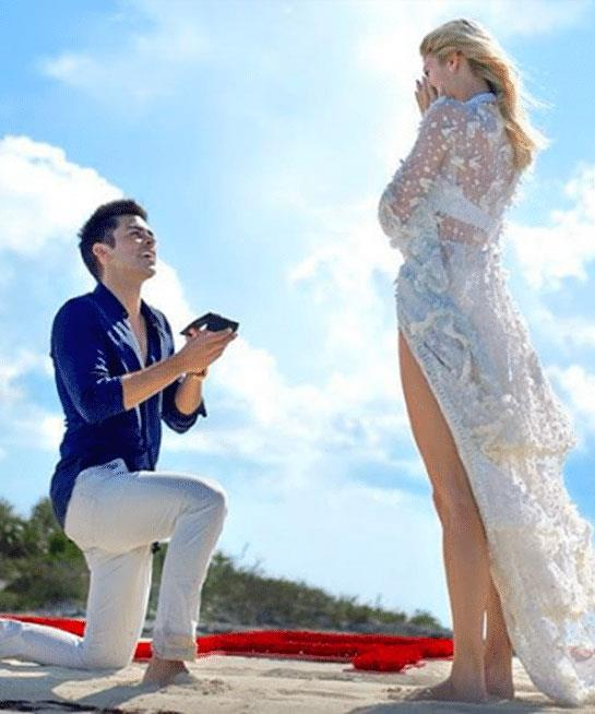 ***Devon Windsor***<br><br> For a beach proposal (or, should we say, an island hired out for a proposal, on which the words 'WILL YOU MARRY ME?' were written into the sand and flown over in a private plane), Victoria's Secret angel Devon Windsor wore a sheer lace coverup over a white bikini.