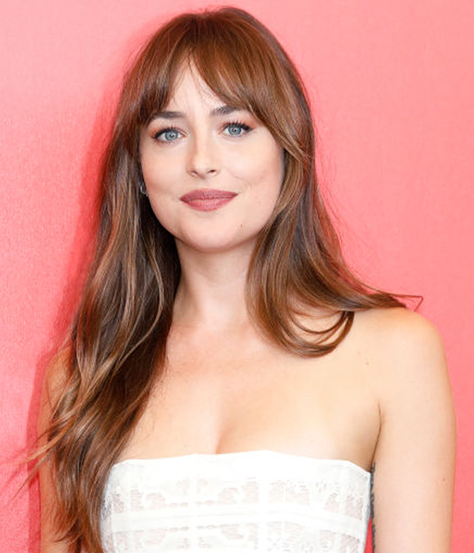 **Dakota Johnson**<br></br> Another fringe devotee who recently updated her trademark cut is Johnson, who swapped her straight-across bangs for a piecey split style.