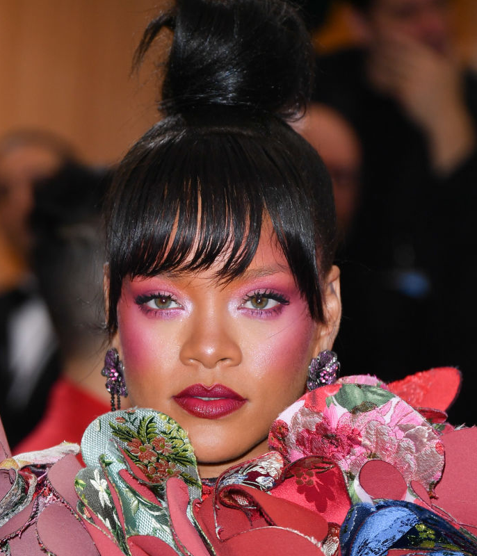 **Rihanna**<br></br> Rihanna may switch between longer layers and a front fringe somewhat frequently, but when the latter looks this good, iconic status is still applicable.