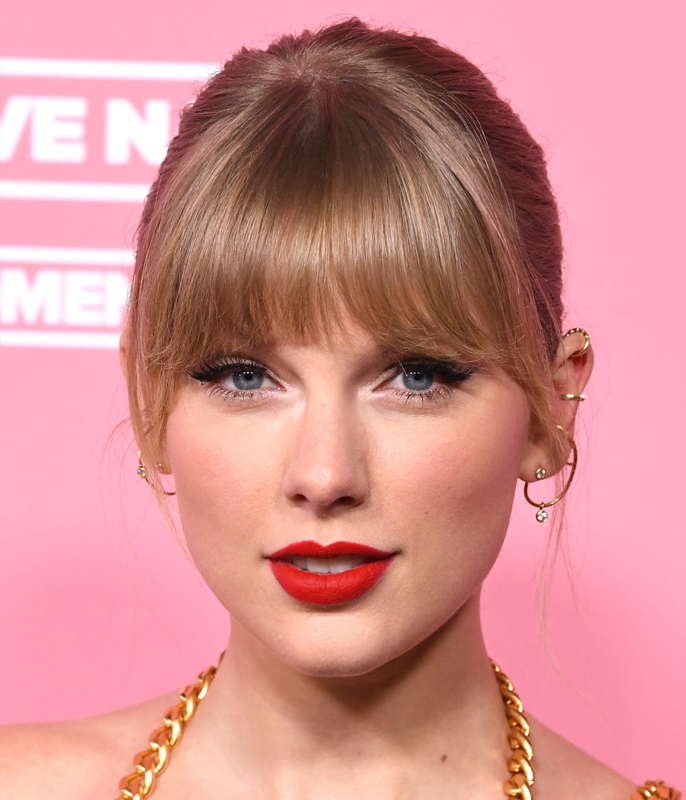 **Taylor Swift**<br></br> Swift's straight-cut bangs sit toward the blunt end of the spectrum, with the longer length grazing her lashes.