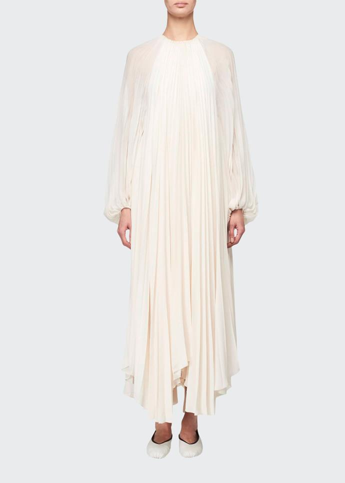 "White 'Martina' Knife Pleated Full-Sleeve Dress by The Row, $8,820 at [Lyst](https://www.lyst.com.au/clothing/the-row-martina-knife-pleated-full-sleeve-dress/|target=""_blank""