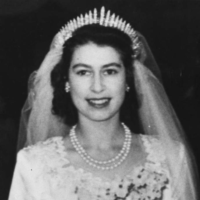 """**The tiara:** Queen Mary's Fringe Tiara.<br><br> **The history:** Another kokoshnik-style tiara, this fringe piece (named because of its spires) was made for Queen Mary of Teck. The then-Princess Elizabeth wore it on her wedding day. It was also worn by Princess Anne for her wedding in 1973 and by Princess Beatrice for [her wedding in 2020](https://www.harpersbazaar.com.au/bazaar-bride/princess-beatrice-wedding-dress-tiara-20527