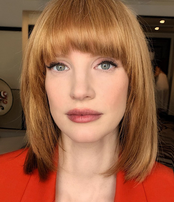 **Jessica Chastain**<br></br> Chastain's blunt brow-skimming bangs exude classic chic, blending seamlessly with her glossy lob.