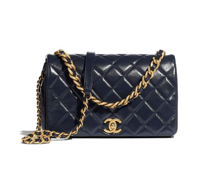 "Flap Bag in Navy Blue, $6,960 by [Chanel](https://www.chanel.com/au/fashion/p/AS1977B03446N7384/flap-bag-shiny-lambskin-gold-tone-metal/|target=""_blank""