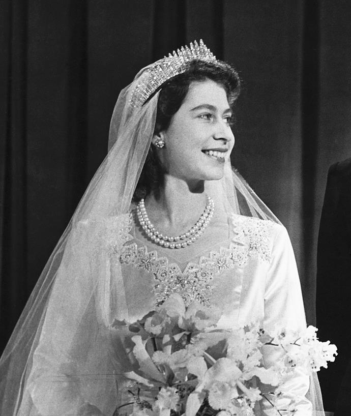 "**Queen Elizabeth II Wearing The Fringe Tiara At Her Wedding In 1947**<br><br>  Loaned to her by the Queen Mother as her 'something borrowed', a then-Princess Elizabeth wore the famous 'Fringe' tiara for the first time at her wedding to a then-Lieutenant Philip Mountbatten. Widely regarded as of the most beautiful royal tiaras, the stunning piece consists of rows of diamond spikes in a fringe pattern, and can also be worn as a necklace.<br><br>  Unfortunately, just hours before she was meant to walk down the aisle, the tiara snapped in two as the hairdresser was securing her veil (a bride's worst nightmare).<br><br>  ""The Fringe Tiara was given to Queen Elizabeth on her wedding day, and the hairdresser broke it. On that day, they had it police escorted to the House of Garrard workshops,"" a representative of House of Garrard told [*Marie Claire* U.S.](https://www.marieclaire.com/celebrity/a12794312/royal-jeweler-house-of-garrard-interview/