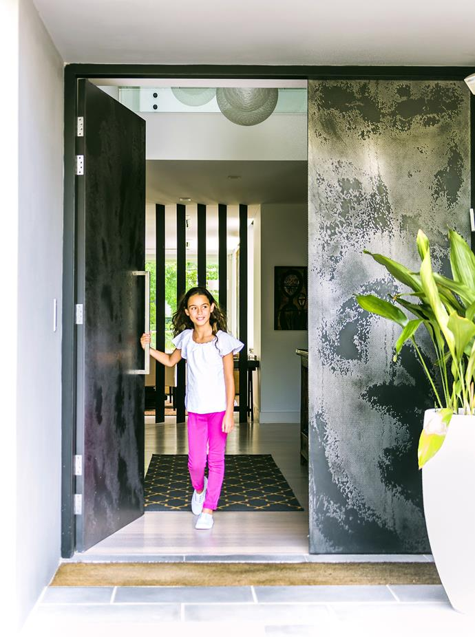 At this renovated home in Sydney's Eastern suburbs, a sense of 'something special' is evident on arrival at the double front door with a custom metallic finish.