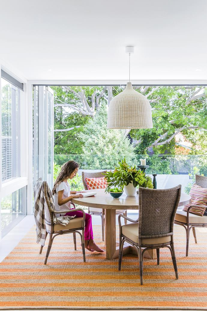 """With leafy views, this casual dining space has the best seats in the house.   **Table** from [MCM House](http://mcmhouse.com/