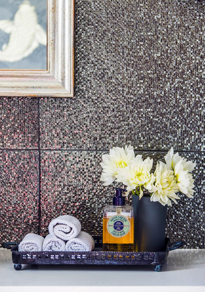 """The bathroom tiles help create a jewel-like space in the powder room. For similar tiles, try [Di Lorenzo Tiles](http://www.dilorenzo.com.au/