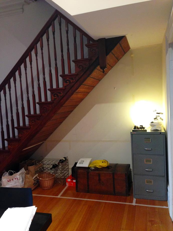 "Before the renovation, the ""awkward space"" under the stairs was underutilised and cluttered."