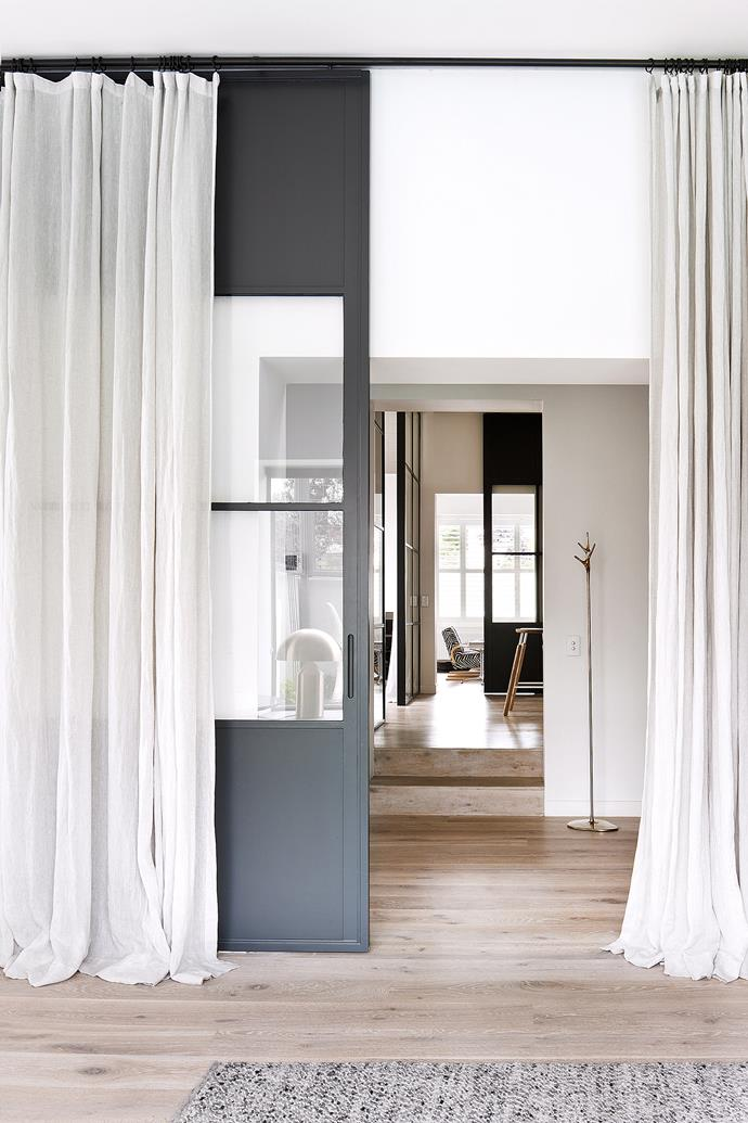Sheers curtains are used in this space to divide up rooms. Photo: Shannon McGrath / bauersyndication.com.au
