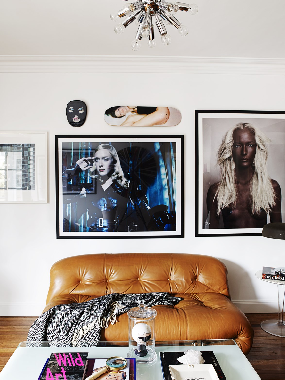 "Interior designer Dina Broadhurst has transformed an old two-bedroom [Art Deco apartment](https://www.homestolove.com.au/gallery-dinas-art-deco-sydney-apartment-reno-1497|target=""_blank"") into a cosy home with an artistic edge. Here, a Daniela Federici photograph of actress Chloë Sevigny, a photograph by Justin Cooper and other striking objets d'art hang above a vintage Soriana sofa."