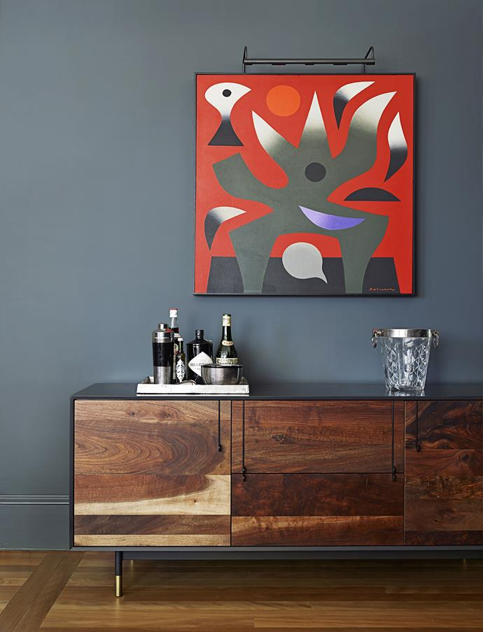 """We wanted to take out the formality, make it funky and edgy, glamorous and moody,"" says designer Sarah Davison, referring to both formal and casual living areas.   **Walls** painted in [Dulux](http://www.dulux.com.au/