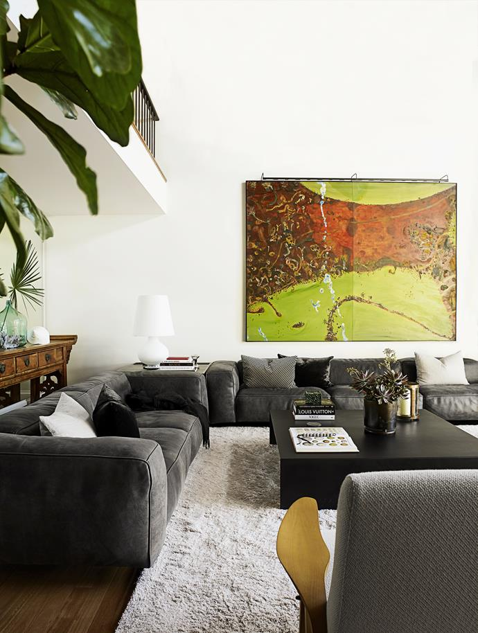 "The artwork, *Kimberley in Flood*, by renowned Australian artist John Olsen, looks ""amazing, fun and gorgeous"", says the owner. It sits above an Edra Sofà sofa from [Space](http://www.spacefurniture.com.au/