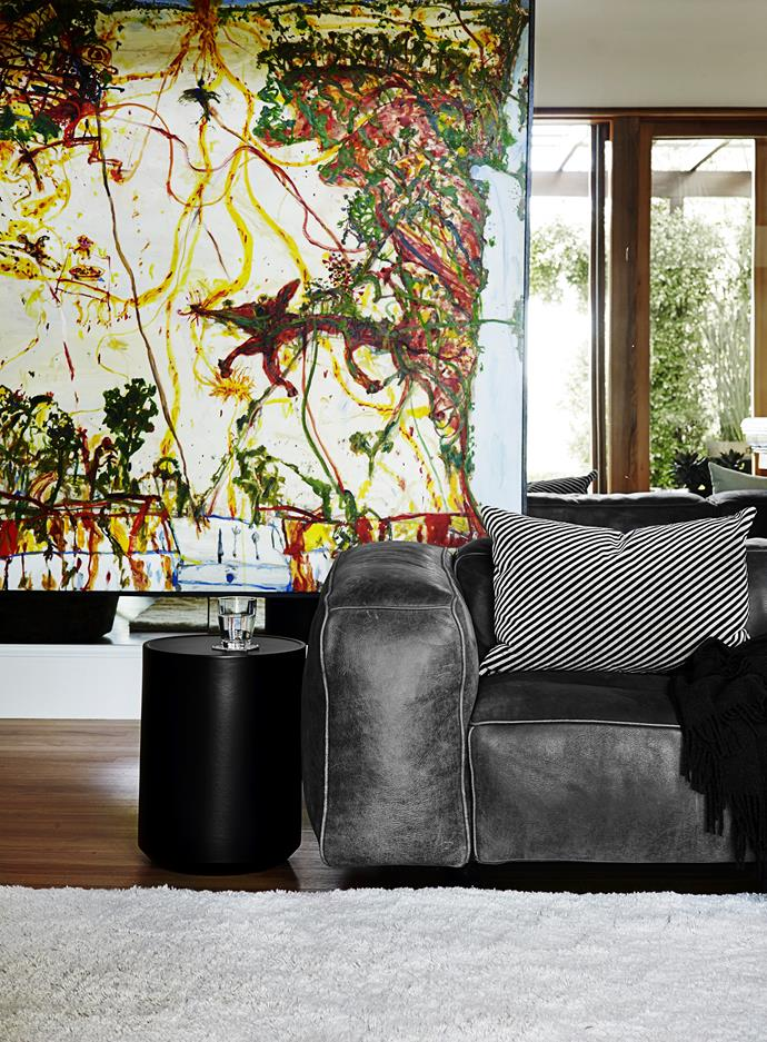 "This family room is a room for comfort, with sprawling leather sofas. ""It had to be relaxed, but not too informal, with a cosy, chill-out feel,"" says designer Sarah Davison.   *Table Landscape* **artwork** by John Olsen. Edra Sofà **sofa** from [Space](http://www.spacefurniture.com.au/