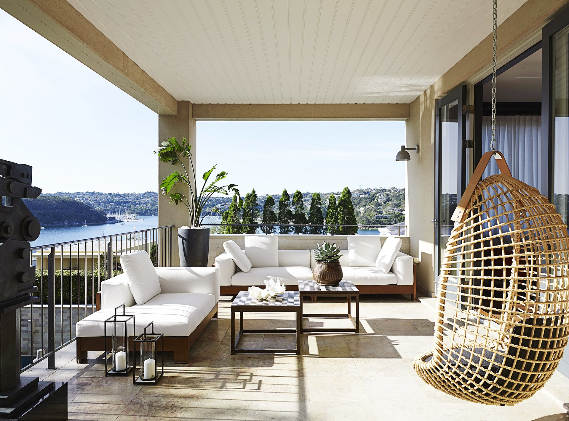 This Tuscan-style house is privy to expansive Sydney Harbour views, and the best place to enjoy them is from this chic balcony off the formal living room. *Photo:* Anson Smart.