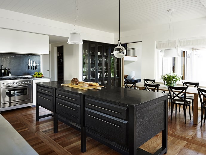 "Walls were shifted in the kitchen to accommodate a cool room, walk-in pantry and a glass-fronted storage wall, the only structural changes in the house. When they selected the colour of the classic marble for the benchtop, designer Sarah Davidson told the owner it's either ""the little black dress or the little white dress, both are timeless"". The owner chose the black, echoed in the splashback and behind the china cabinet, ""so it's not a flat wall, to give it life and make it inclusive and warm,"" says Sarah.   Island **bench** in Nero Marquina marble from [SNB Stone](http://www.snb-stone.com/