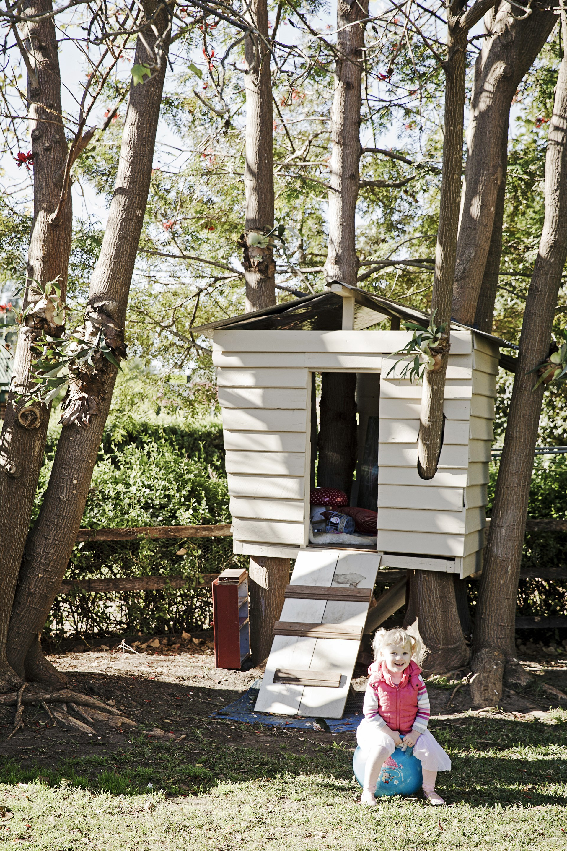 "After renovating the house, Jodie and Simon used the leftover wood to build a cubbyhouse. ""Our daughter Bailey May loves dragging Poppy, our dog, up there,"" says Jodie. Take the tour through their [charming rustic cottage](http://www.homestolove.com.au/gallery-jodie-and-simons-rustic-cottage-renovation-1520/?utm_campaign=supplier/