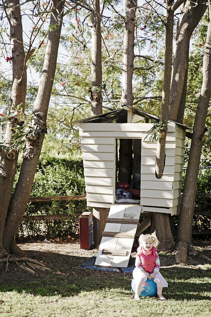 """The cubbyhouse was built using wood left over from the renovation. """"Our daughter Bailey May loves dragging Poppy, our dog, up there,"""" says Jodie."""