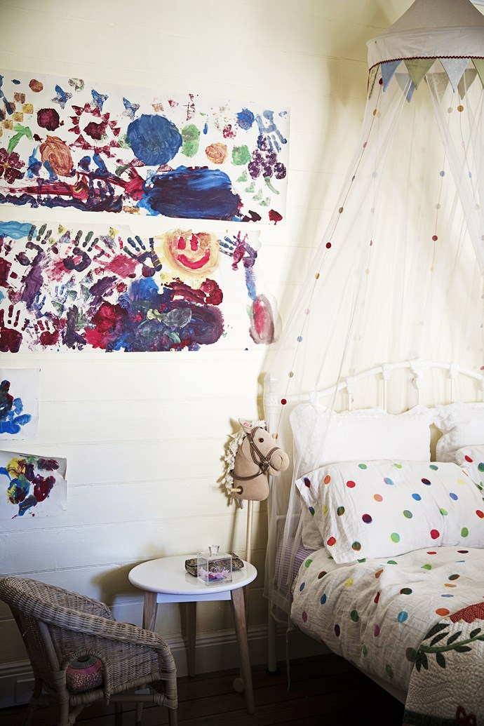 """Daughter Bailey May's paintings are proudly displayed on her bedroom wall. The spotty [Ikea](http://www.ikea.com.au/ target=""""_blank"""") bedlinen and mosquito net are a fun alternative to pink."""
