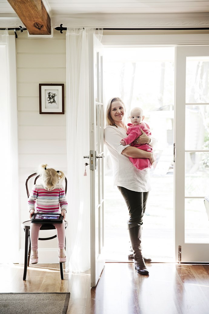 """Jodie holding baby Penny and little Bailey May seated. Jodie replaced the old blinds with [Ikea](http://www.ikea.com.au/ target=""""_blank"""") drapes. It only cost $6 to dress each window."""