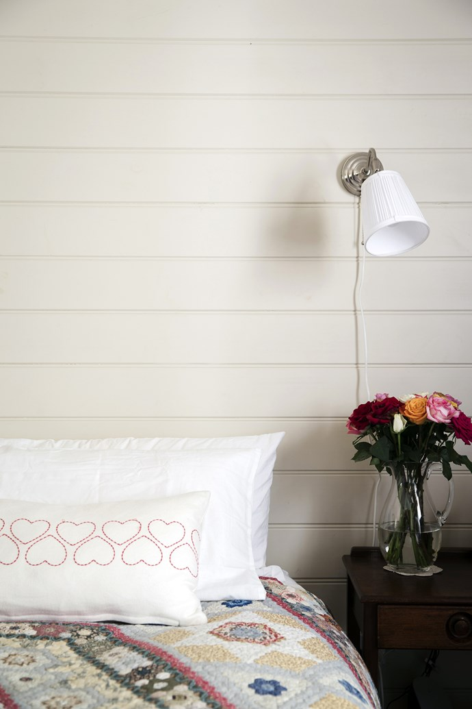"""The bedroom is kept simple and cosy with bedlinen from [Sheridan](http://www.sheridan.com.au/ target=""""_blank"""") and a pair of white wall lamps picked up for a song from [Ikea](http://www.ikea.com.au/ target=""""_blank"""")."""