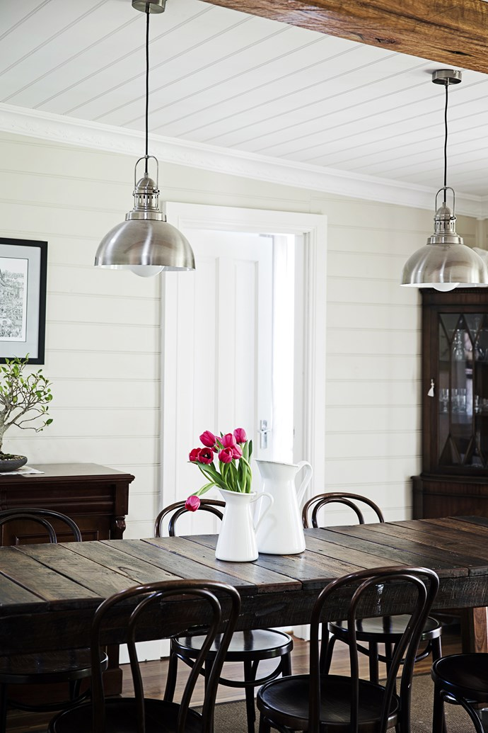 """Complementing Simon's dining table are bentwood chairs and a drinks cabinet bought from Gumtree. The walls are painted in [Dulux](http://www.dulux.com.au/ target=""""_blank"""") Aqua Enamel in Antique White U.S.A."""