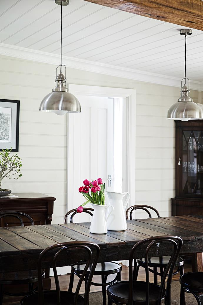 """Complementing Simon's dining table are bentwood chairs and a drinks cabinet bought from Gumtree. The walls are painted in [Dulux](http://www.dulux.com.au/