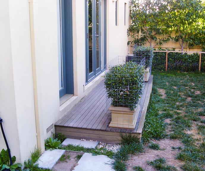 Before the renovation, the garden featured a small existing deck in a neglected courtyard.
