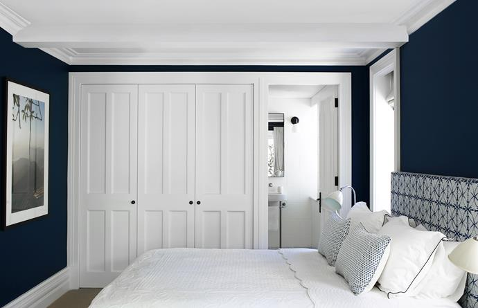 "Striking blue-black walls in [Dulux](http://www.dulux.com.au/|target=""_blank"") Prestige Blue create depth in the guestroom of this Federation home in Sydney. ""The walls complement the Martyn Lawrence Bullard fabric from [Tigger Hall Design](http://www.tiggerhall.com.au/