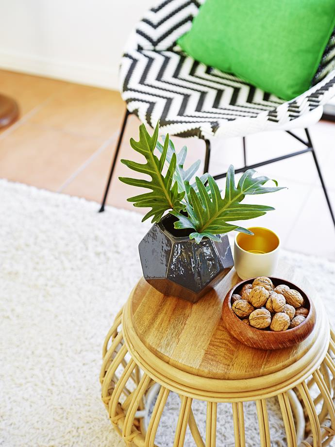 A cane drum stool balances the bold black and white seat with green cushion.