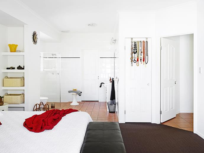 The master bedroom has a hotel-suite feel with the ensuite open to the sleeping zone.