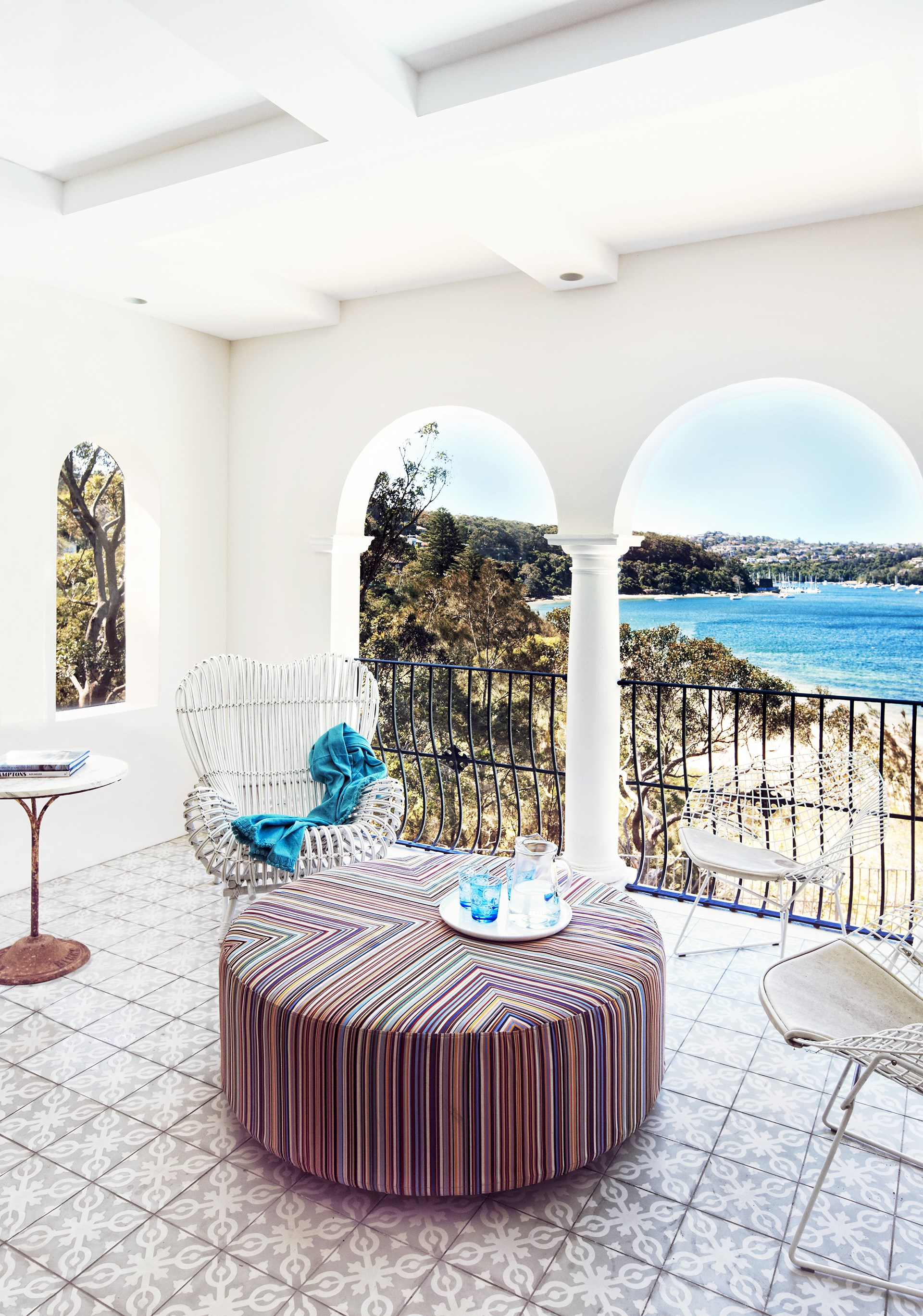 "This [Spanish Mission home](http://www.homestolove.com.au/a-waterfront-luxury-home-has-a-hollywood-makeover-1613|target=""_blank"") features a gorgeous covered balcony that enables the owners to take advantage of the Sydney Harbour views. *Photo:* Jason Ierace"
