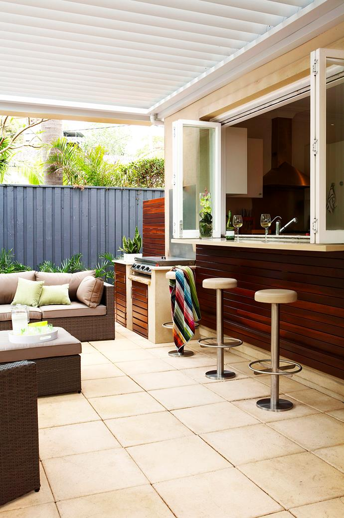 "Bi-fold windows connect the outdoor room, designed by [Secret Gardens](http://www.secretgardens.com.au/|target=""_blank"") with the kitchen in this home on Sydney's Northern Beaches. Bar stools keep the feel casual, and the space is furnished with pieces from [The Outdoor Furniture Specialists](http://www.tofs.com.au/
