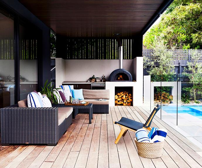 "Extra-wide merbau boards and ceiling cladding lend this Melbourne outdoor room its appealingly shady feel. ""We enjoy casual entertaining and use this space year-round,"" says homeowner Andrew Johnston. ""It's a comfortable spot that's well utilised."" Wicker pieces from the family's furniture store, [Satara](http://www.satara.com.au/