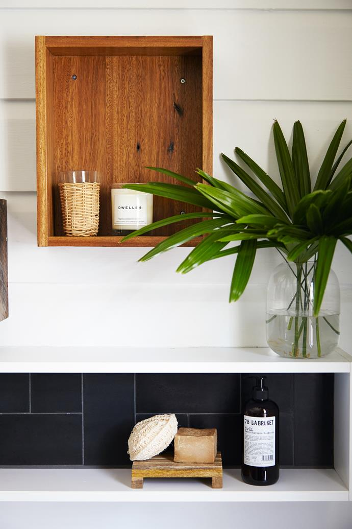 Reclaimed timber from the site was used to create wall-hung storage and display boxes were made from recycled floorboards.
